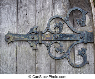 Curly iron Hinge - An Iron decorative hinge on a weathered...