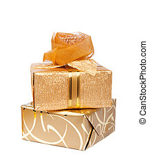 Beautiful gift boxes in gold paper with a silk rose isolated...