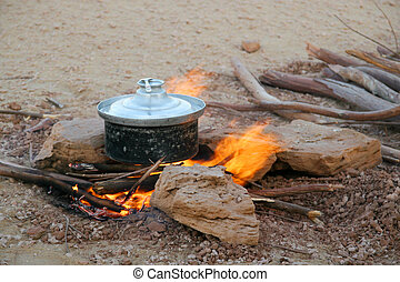 Cooking in the desert - Cooking lunch on the desert ground