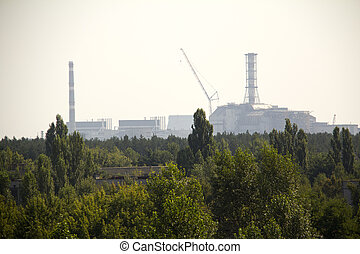 Chernobyl - Forest and Chernobyl nuclear reactor in the...