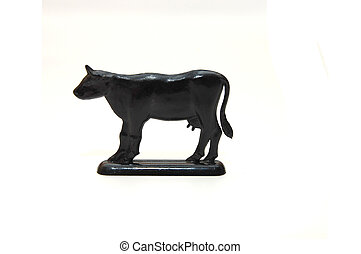 toy plastic cow, isolated on white ground