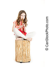 young girl with soprano recorder and white background