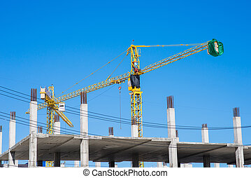 Big yellow crane in constuction site