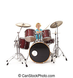 young boy playing drums against white background