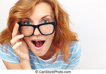 Beautiful young woman with black glasses surprised.