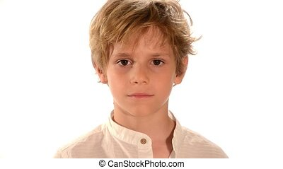 Portrait of young boy showing thumb - Beautiful blond kid...