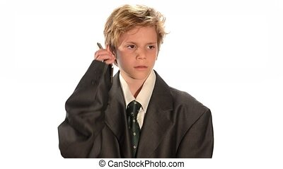Business kid - Young boy in an oversized business suit on...