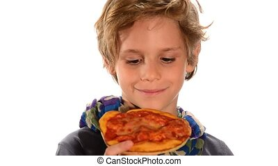 Handsome child eating a pizza - Portrait of a blond kid...
