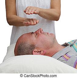 Healer balancing Third Eye Chakra - Female Healer balancing...