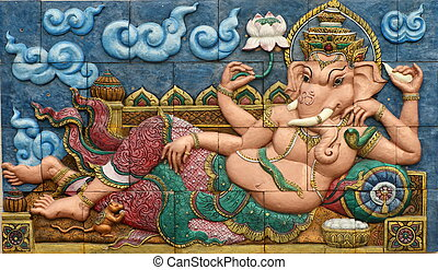 ganesh hindu god on wall - Low relief cement Thai style...