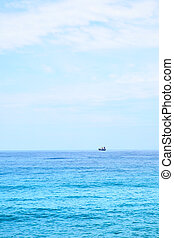 Mediterranean sea and ship on the horizon