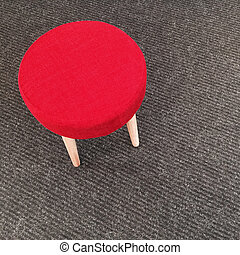 Red stool on gray carpet floor - Modern red stool on gray...