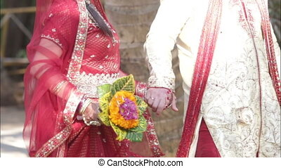 Indian bride groom walking - Indian bride and groom walking