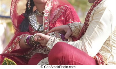 Indian bride groom hands stroking