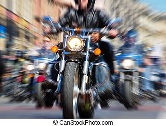 Motorcycle - blurred bike riders rushing at city streeet