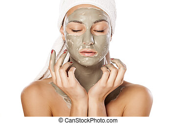 face mask - young beautiful woman posing with a mask on her...