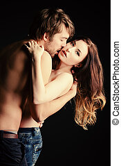 intimacy - Beautiful passionate naked couple in love. Over...