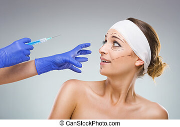 Beautiful woman with plastic surgery, the fear of the needle...