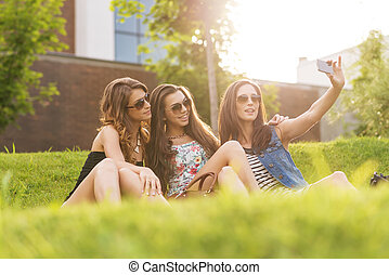 Selfie Photo3 pretty woman enjoying the nice weather on the...