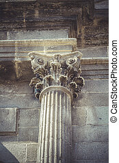 Stonework, Corinthian capitals, stone columns in old building in
