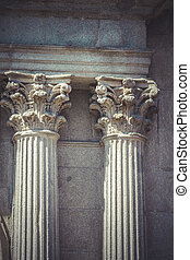 Temple, Corinthian capitals, stone columns in old building in Sp