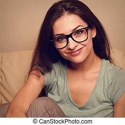 Happy smiling girl in spectacles. Closeup vintage portrait