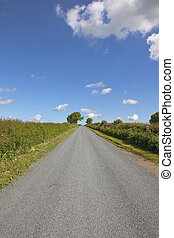 resurfaced country road - a resurfaced rural highway in the...