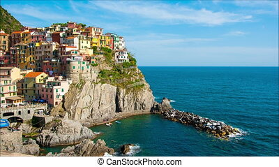 Picturesque view of Manarola, Laguria, Italy in the sunny summer day,timelapse