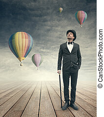 Imaginative vintage businessman with hot air ballons -...