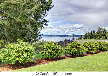 Fenced backyard with water view - Green fenced backyard with...
