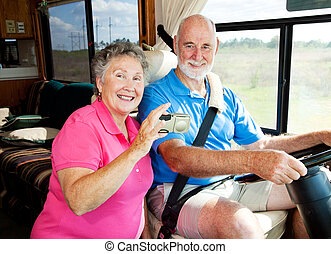 RV Seniors - Tech Savvy - Senior couple using a GPS to...