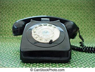 Telephone - Old black vintage telephone close up
