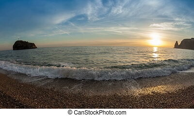 Waves on the seashore at sunset