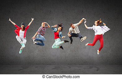 group of teenagers jumping - summer, sport, dancing and...