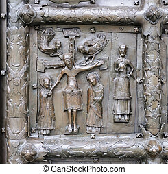 Bas-relief with Jesus Christ on ancient bronze gate in...