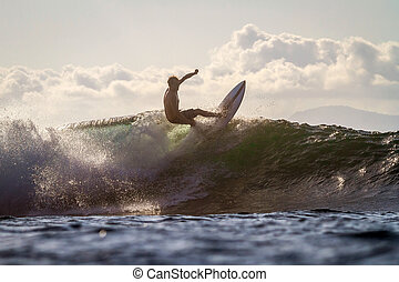Surfing a Wave. - Picture of Surfing a Wave at Sunrise Time
