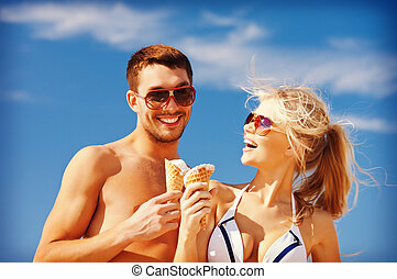happy couple with ice cream - bright picture of happy couple...