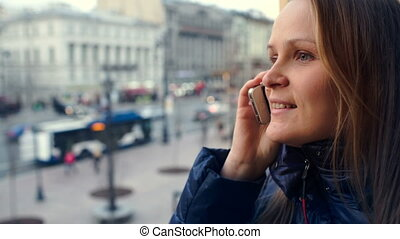 Emotional woman having a phone talk outdoor