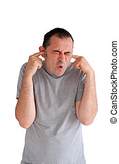 man preventing hearing damage by blocking ears from a loud...