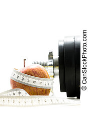 Apple wrapped around with measuring tape - Red apple wrapped...