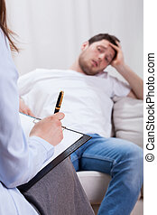 Lazy man at psychotherapy room - The lazy man at...