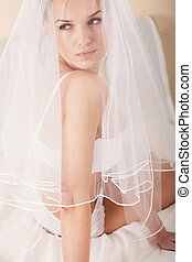 Sensual wife hiding under the white veil in bedroom