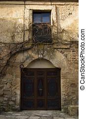 Classic wooden door in mediterranean village