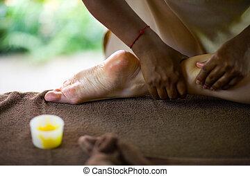 Foot Massage - Therapist making spa reflexology foot massage