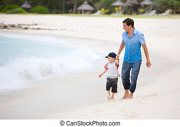 Family vacation Happy father and son on the beach