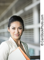 Portrait of a happy Asian businesswoman. - Portrait of a...