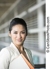 Portrait of a happy Asian businesswoman. - Portrait of a...