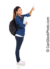 female university student pointing at empty copy space