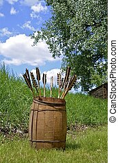 Arrows stored in a wood barrel - Arrows are stored in a...