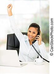 businesswoman hearing good news on the phone